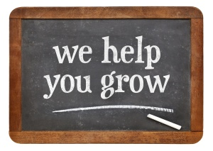we help you grow blackboard sign
